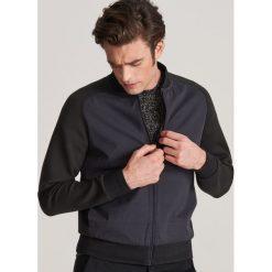 Czarne kurtki męskie ze sklepu Reserved Kolekcja zima 2020