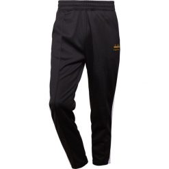 d4bc17c4a The Editor DIADORA TRACK PANTS STRAIGHT Spodnie treningowe black. Długie  spodnie sportowe męskie The Editor ...