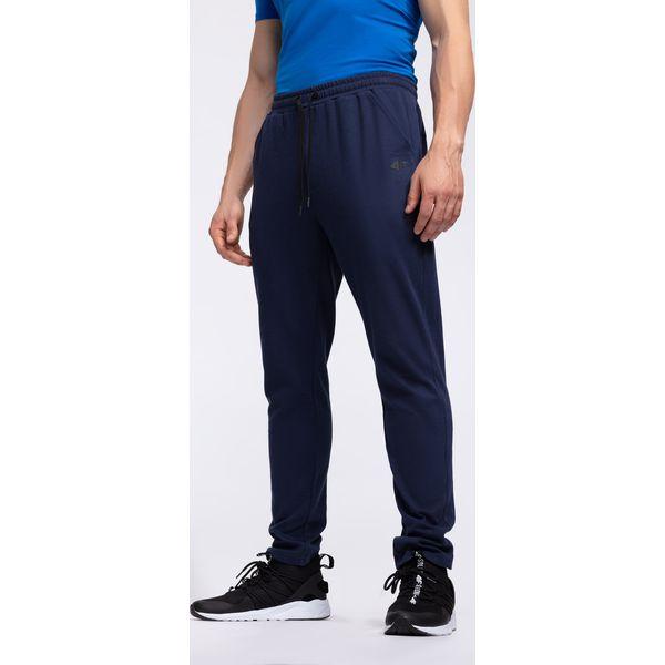 879987ffeca1 Spodnie dresowe męskie SPMD302 - granat melanż - Spodnie dresowe męskie  marki 4f. W wyprzedaży za 79.99 zł. - Spodnie dresowe męskie - Spodnie i  szorty ...