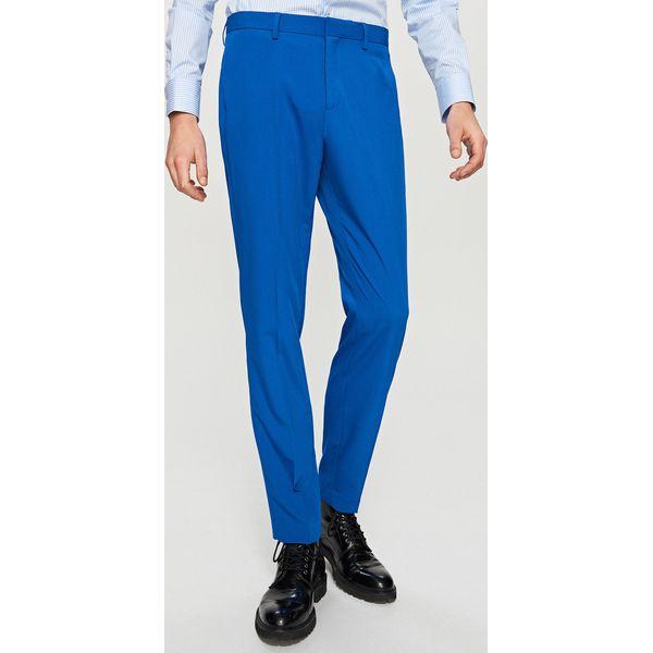 b028ea340c51d Spodnie garniturowe slim fit - Niebieski - Niebieskie eleganckie ...