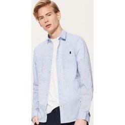 33af79e3d85a8 Wyprzedaż - odzież męska marki House - Kolekcja lato 2019. -29%. Koszula z  kontrastowymi detalami - Niebieski. Koszule męskie marki House.
