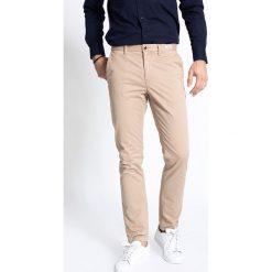 b7d49e7b961ea Eleganckie spodnie męskie marki Tommy Hilfiger - Kolekcja wiosna ...