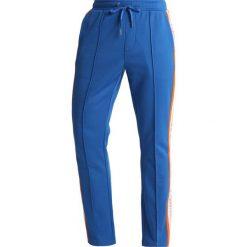 e9c10e7dbcda8 Calvin Klein Jeans SIDE STRIPE TRACK PANTS Spodnie treningowe royal blue.  Długie spodnie sportowe męskie ...