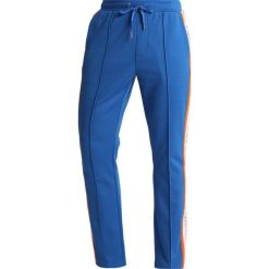 e76ea58d7eee9 Calvin Klein Jeans SIDE STRIPE TRACK PANTS Spodnie treningowe royal blue.  Niebieskie spodnie dresowe męskie ...