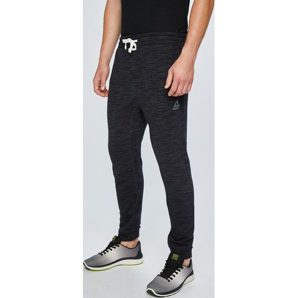 749b93951 Reebok - Spodnie - Długie spodnie sportowe męskie marki Reebok. W ...